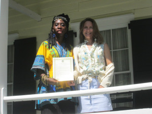 Queen Quet, Chieftess of the Gullah/Geechee Nation and Executive Director of Heyward House, Maureen Richards stand proudly on the porch of Heyward House with the Gullah/Geechee Nation Appreciation Week Proclamation for 2014!